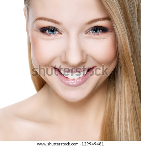 Beautiful smiling blonde on a white background - stock photo