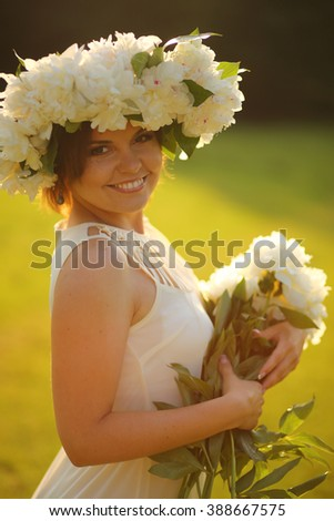 Beautiful smiling bride outdoors
