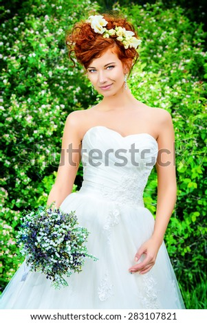 Beautiful smiling bride with chaming red hair. Wedding dress and accessories. Wedding decoration.  - stock photo