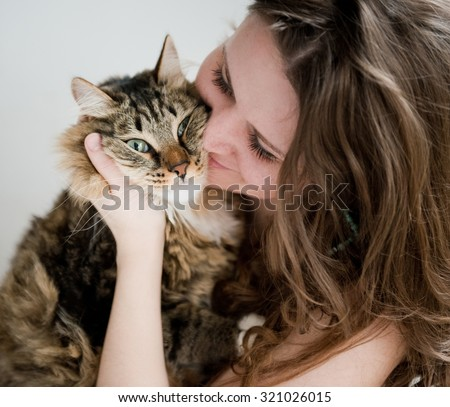 beautiful smiling brunette girl and her ginger cat