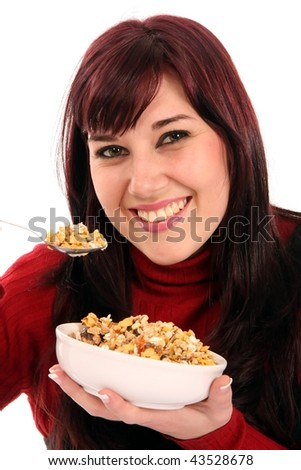 Beautiful smiling brunette girl eating a plate of healthy muesli
