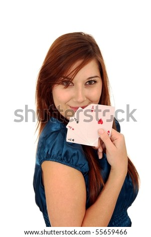 Beautiful smiling brunette girl holding all the aces - stock photo