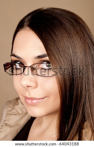 Beautiful smiling brunette with grasses - stock photo