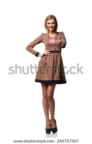 Beautiful smiling business woman, holding a card in hand, isolated on white background - stock photo