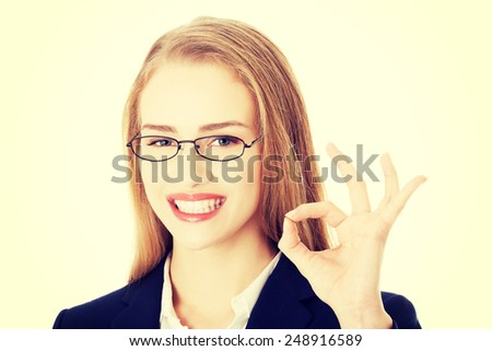 Beautiful smiling business woman showing perfect sign. - stock photo