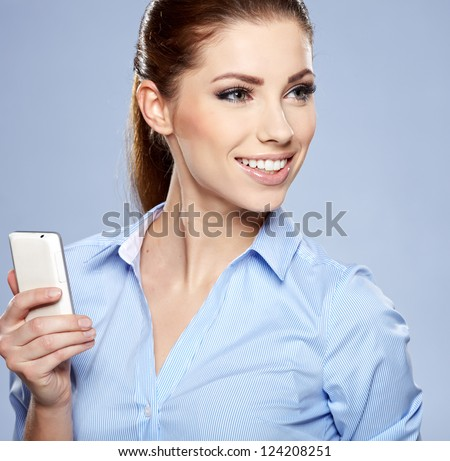 Beautiful smiling business woman talking on the phone - stock photo