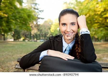 beautiful , smiling businesswoman break, relaxing in park - stock photo