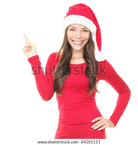 Beautiful smiling christmas santa woman pointing up showing copyspace. Isolated on white background.