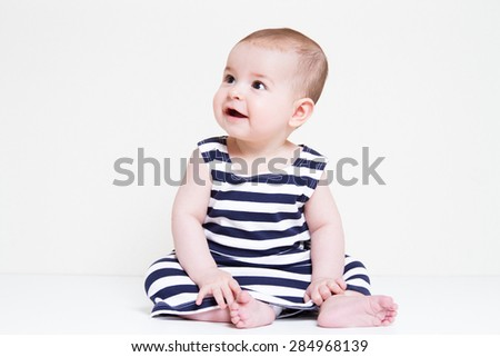 Beautiful smiling cute baby girl - stock photo