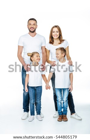 Beautiful smiling family with two children standing in white t-shirts isolated on white