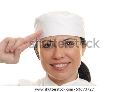 Beautiful smiling female chef salutes.  White background. - stock photo