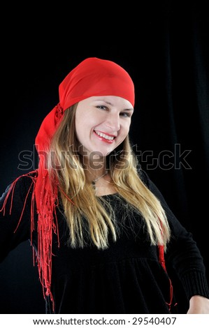 Beautiful smiling fortuneteller, on black background - stock photo
