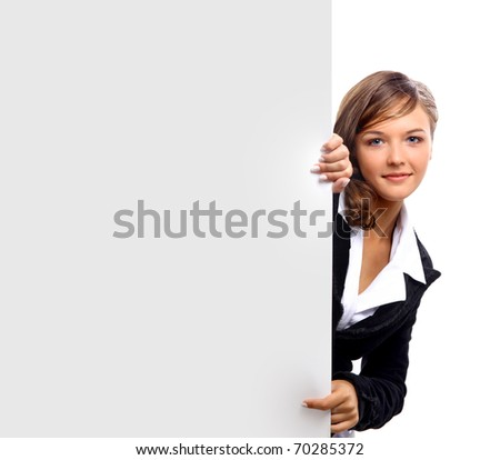 beautiful smiling girl holding a blank billboard. - stock photo