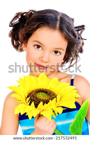 Beautiful smiling girl in bright summer dress holds a sunflower. Isolated over white. - stock photo