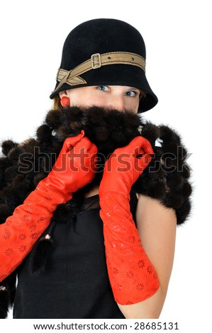 beautiful smiling girl in hat and red gloves hides smile, isolated on white - stock photo
