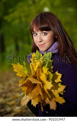 Beautiful smiling girl in park - stock photo