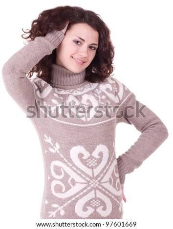 Beautiful smiling girl in sweater on white background - stock photo