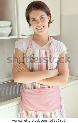 beautiful smiling girl in the kitchen - stock photo