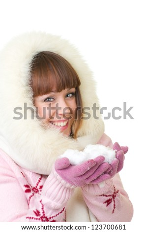 Beautiful smiling girl in warm clothes with snow on white background - stock photo