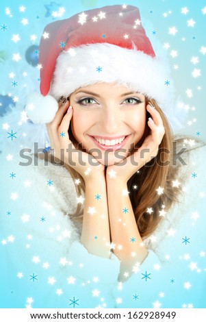 Beautiful smiling girl near Christmas tree close-up