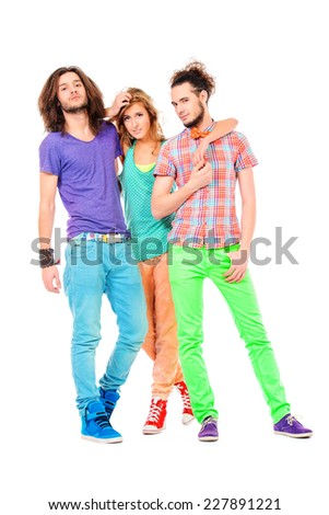 Beautiful smiling girl stands between two handsome young men. Isolated over white. - stock photo