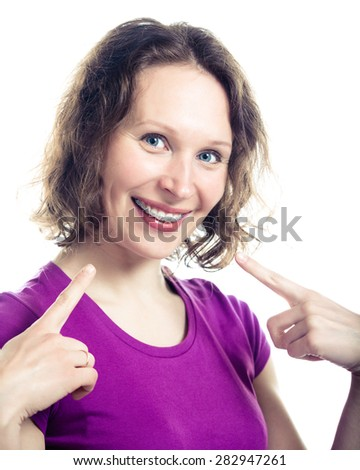 Beautiful smiling girl wearing braces on a white background. - stock photo
