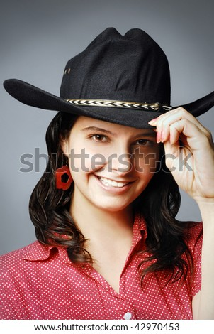 Beautiful smiling girl with black cowboy hat