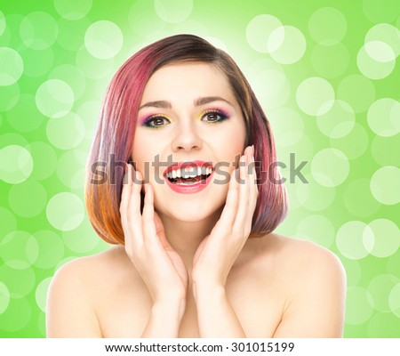 Beautiful smiling girl with colorful make-up on bubble background. - stock photo