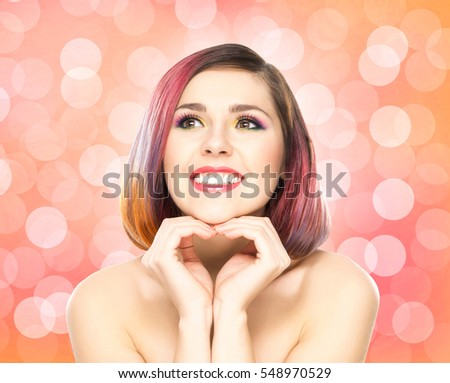 Beautiful smiling girl with colorful make-up on bubble background.