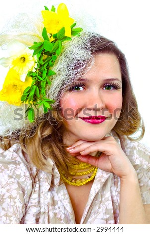 Beautiful smiling girl with narcissus in her hair