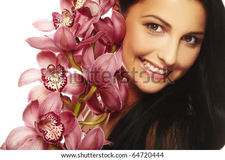 Beautiful smiling girl with nice flower - stock photo