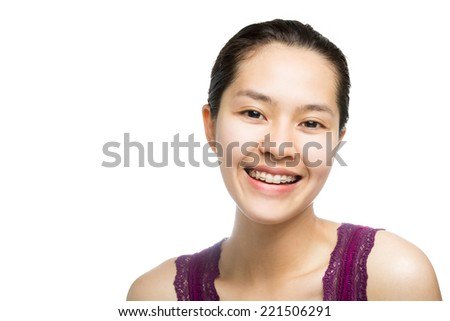 Beautiful smiling girl with retainer for teeth isolated on white background. - stock photo