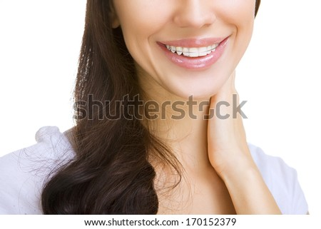 Beautiful smiling girl with retainer for teeth, on white - stock photo