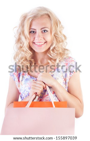 Beautiful smiling girl with shopping bags