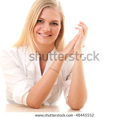beautiful smiling happy woman with blond hair sitting at the table