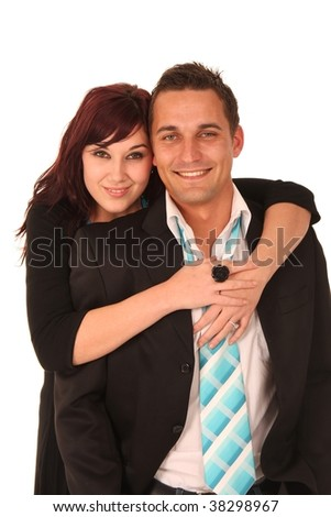Beautiful smiling lady with her arms around her handsome boyfriend