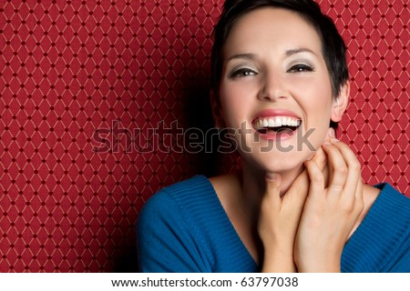 Beautiful smiling laughing young woman - stock photo