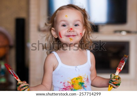 beautiful  smiling  little blonde girl  with brush  paints amazing fresh trendy summer spring joy happy look cute studio impressions lady