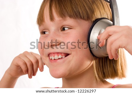 Beautiful smiling little girl with headphones isolated on white background - stock photo