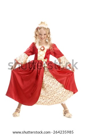 Beautiful smiling little girl with long blonde hair in the princess costume showing her red and gold empire dress at the white background. Very frightening face! - stock photo
