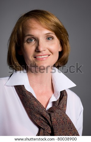 Beautiful smiling middle-aged woman with a happy look. - stock photo