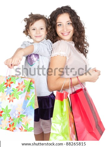 beautiful smiling mother and little daughter doing shopping together over white background - stock photo