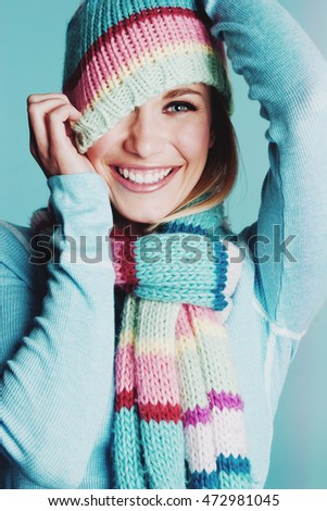 Beautiful smiling playful winter woman