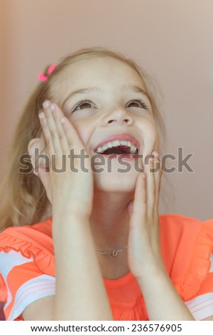 Beautiful smiling schoolgirl in pink dress, isolated on white background. - stock photo