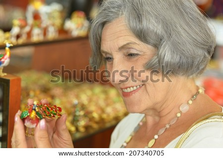 Beautiful smiling senior woman at souvenir store