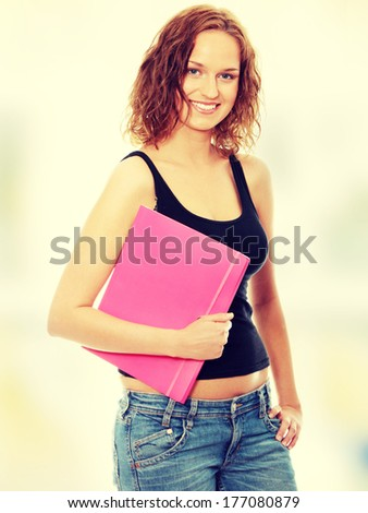 Beautiful smiling student woman. - stock photo