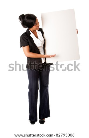 Beautiful smiling successful corporate business woman pitching an idea presenting blank whiteboard, isolated.