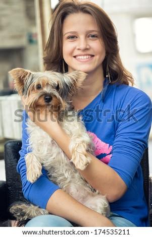 Beautiful smiling teenage girl dog - stock photo
