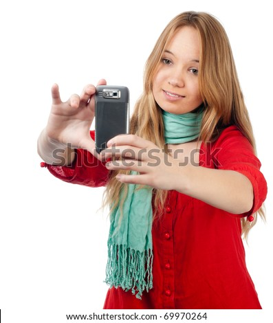beautiful smiling teenage girl taking photo with her mobile phone. Isolated on white background - stock photo