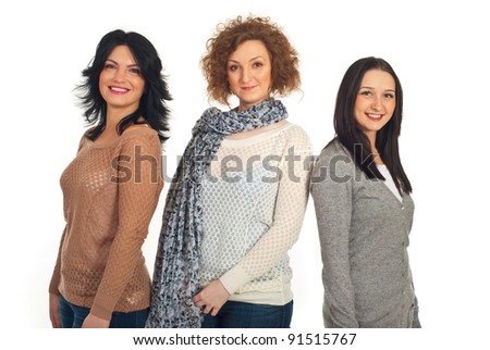 Beautiful smiling three women friends standing in a line isolated on white background - stock photo